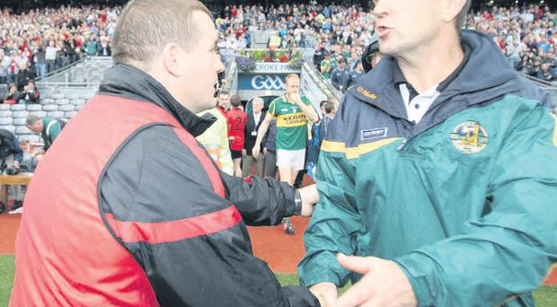 Down manager James McCartan shakes hands with his Kerry counterpart Jack O'Connor