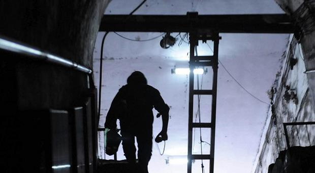 A rescuer exits the pit at the Sanyuandong Coal Mine after a gas leak killed nine workers (AP Photo/Xinhua, Zhu Xiang)
