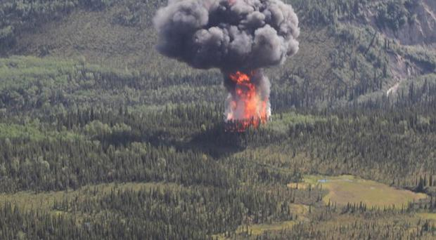 Smoke and flames rise seconds after a cargo plane crashed at the entrance to Denali National Park in Alaska