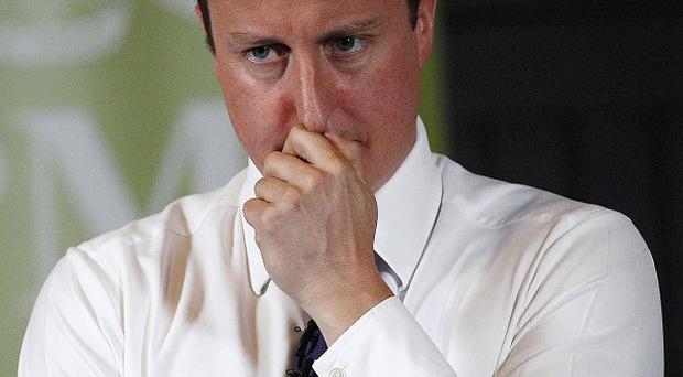 Prime Minister David Cameron says there is 'light at the end of the tunnel'