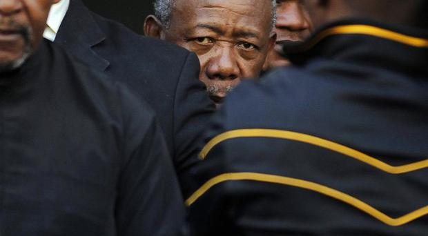 South African former police commissioner Jackie Selebi as he leaves the High Court in Johannesburg. (AP)