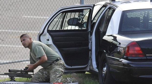A police sharpshooter outside the US workplace where eight people died