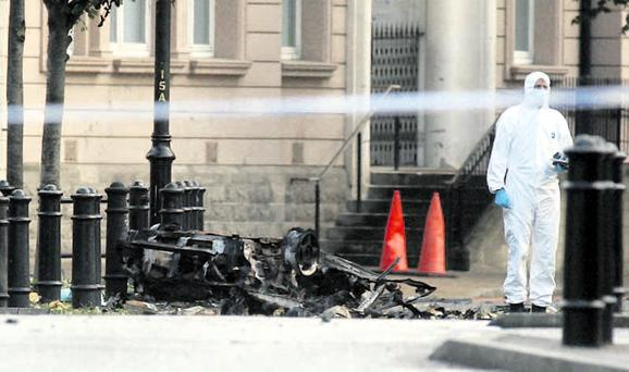 The scene of the bombing at Strand Road police station in Derry is examined