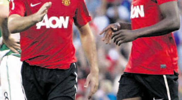 United front: Darron Gibson, left, is carrying on a tradition of Irish players playing at Old Trafford