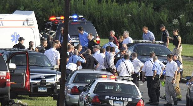 People are evacuated from Hartford Distributors in Manchester after a gunman went on a rampage (AP)