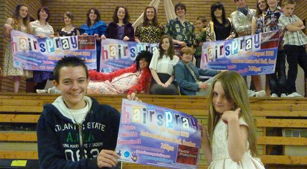Jamie McClelland (front, left) and actress Ellie Fitzsimons (front, right) with the Hairspray cast and production staff