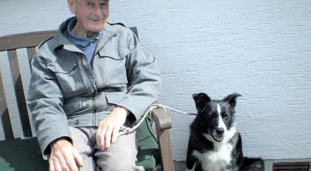 Tragic: Duncan McInnes with his pet dog, whose body was recovered alongside his master from Groomsport harbour last weekend
