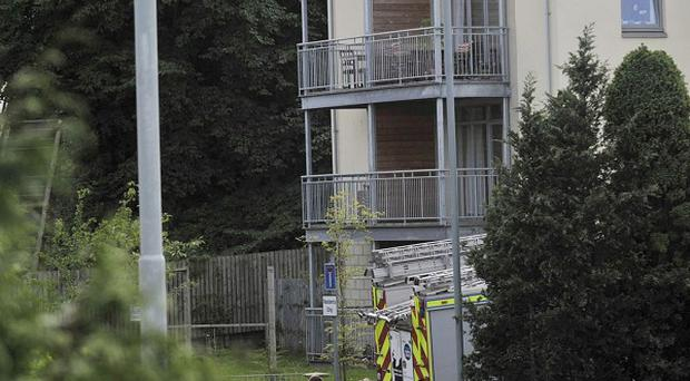 The deaths of three young children in an explosion are being treated as suspicious
