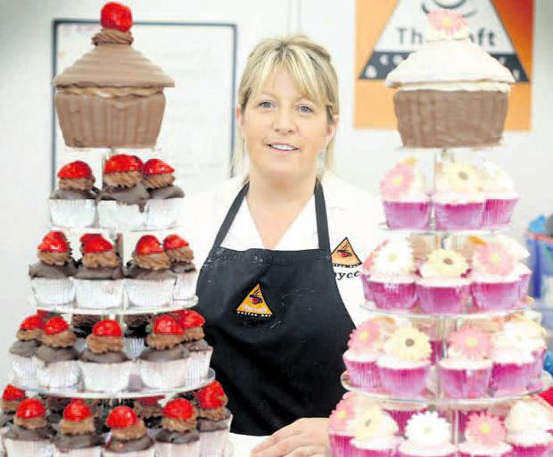 Eye-catching: Joyce Price with her cupcakes on the opening day of the Belfast Taste and Music Festival in Botanic Gardens