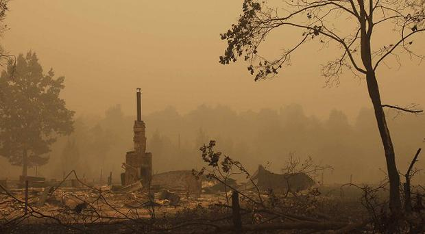 Wildfires have wiped out Russian forests, villages and a military base (AP)