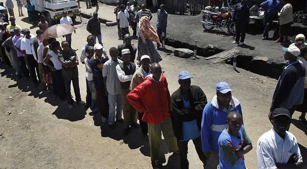 Kenyans queue in numbers to vote on the country's constitution (AP)