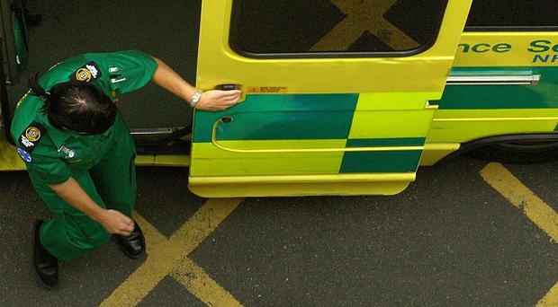 A paramedic was knocked down by a thief who stole his car and drove at him