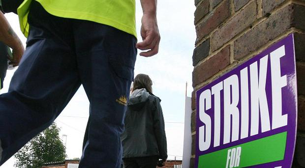 An employers' group has urged the Government to consider banning strikes affecting essential services