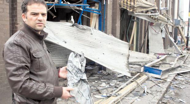 Devastation: Kebab shop owner Lofti Jalloul outside his wrecked premises in Londonderry