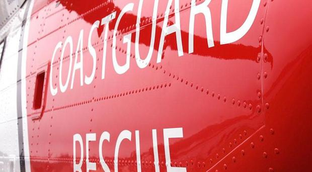Coastguards are looking for a man missing at sea after a collision between a boat and a ferry