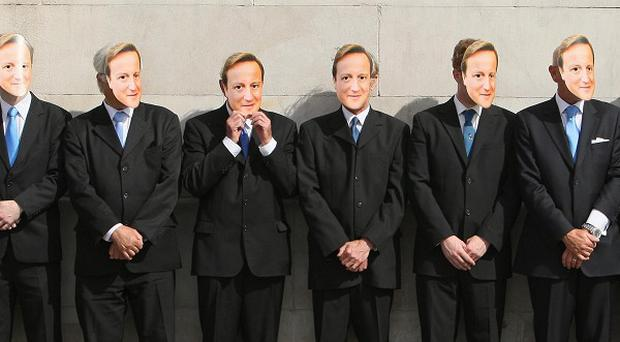Protesters dress as clones of Prime Minister David Cameron in Trafalgar Square
