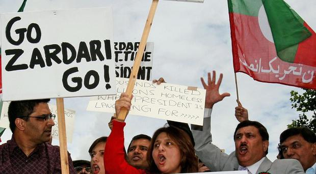 Protesters gather in Birmingham during a visit by Pakistan President Asif Ali Zardari