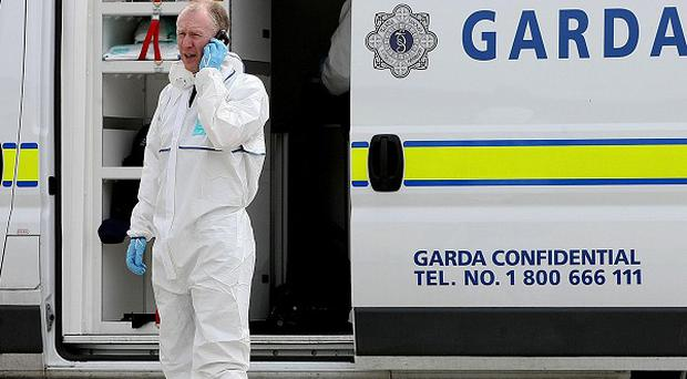 Garda forensic examination after a pub shooting in Co Meath