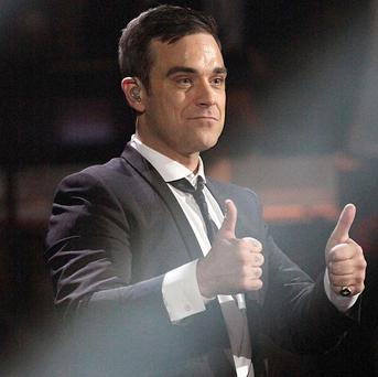 Robbie Williams has reportedly married his girlfriend Ayda Field in his Beverly Hills mansion