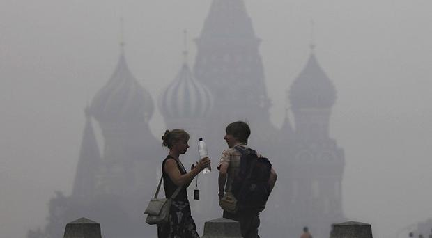 St Basil's Cathedral seen through the heavy smog covering Moscow (AP)