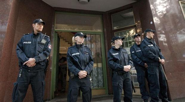 Police guard the entrance to the mosque in Hamburg (AP)