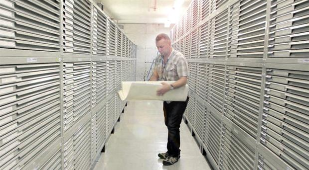 Brett Irwin, a member of the archive staff at the Public Records Office, prepares documents for the move