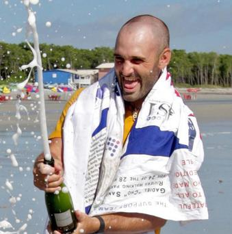 Ed Stafford celebrates arriving to Crispim beach in Marapanim in Brazil's Para state