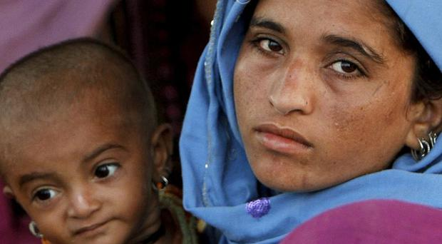 A Pakistani woman with her baby girl in Qadirpur near Sukkur