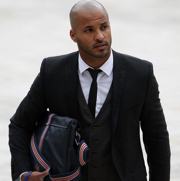 Actor Ricky Whittle denies a dangerous driving charge