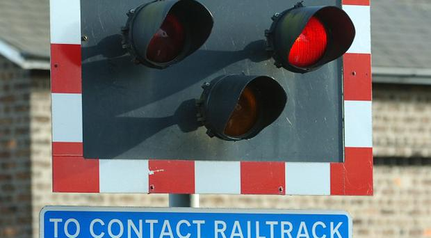 A man has died after he was hit by a train as he attempted to evade police