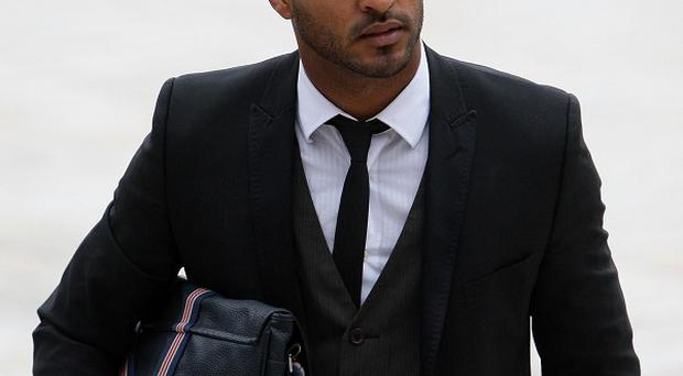 Actor Ricky Whittle denies deliberately driving his car at a photographer