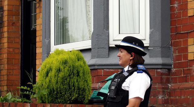 A police community support officer stands on duty outside the home of Melanie Ruddell in Castle Eden, County Durham