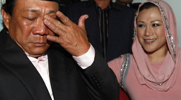 Malaysian lawmaker Bung Mokhtar Radin escaped jail over a polygamous marriage without official consent, as his second wife Zizie Ezette looks on (AP)