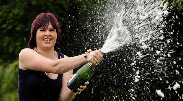 Stacey Bywater, 18, celebrates her lottery win with champagne