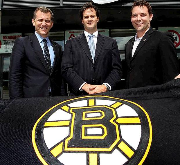 Ken Yaffe, Senior Vice President of the NHL (left) and Tyler Currie, Director of International Affairs for the NHL Players' Association (right) with Belfast Giants General Manager, Todd Kelman