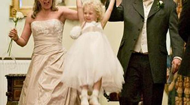 Joanne Richardson and husband Ian with their daughter Mya at their wedding in 2008
