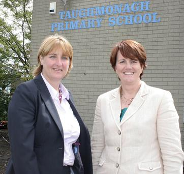 Taughmonagh PS principal Janet Douds and education minister Caitríona Ruane