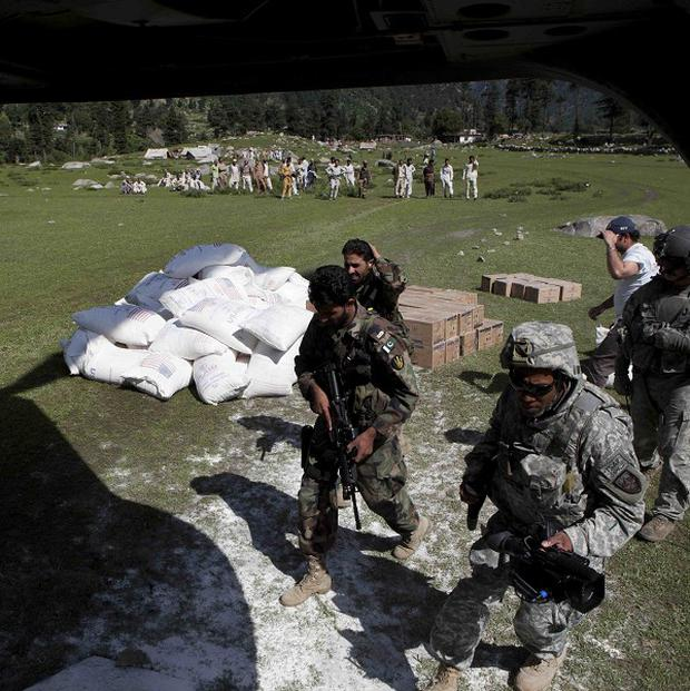 US troops drop food relief for flood-hit people in Kalam, Pakistan
