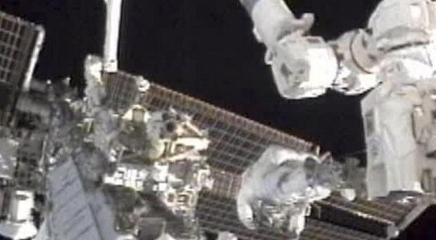 Astronauts Douglas Wheelock and Tracy Caldwell Dyson work on the International Space Station