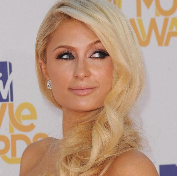 Paris Hilton is being sued for allegedly wearing someone else's hair