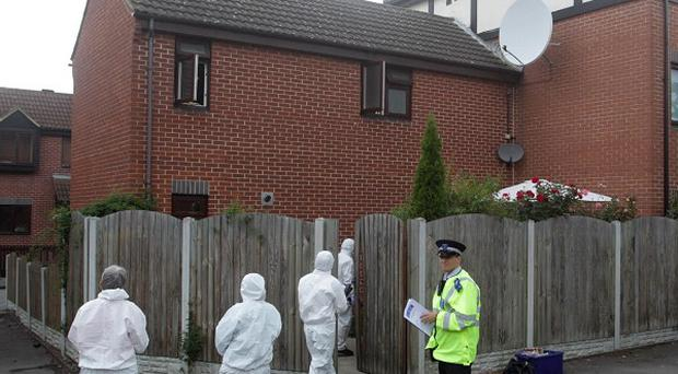 Police at the scene in the Beckton area of east London