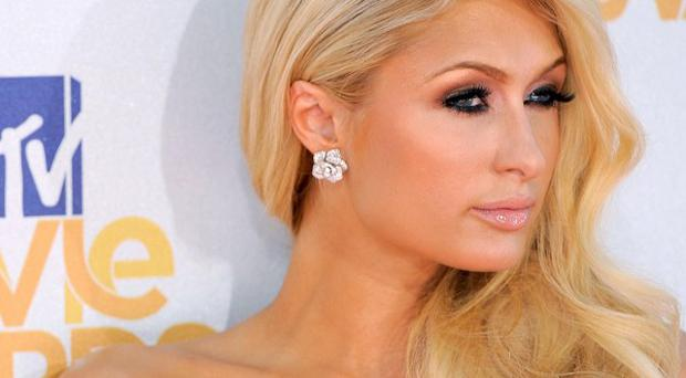 Paris Hilton's lawyers have vowed to faight a lawsuit against her over hair extensions