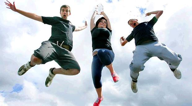 Jumping for joy: Mark Adamson, Emily O'Hare and John Cameron of the 10-strong Belfast outfit MT4UTH