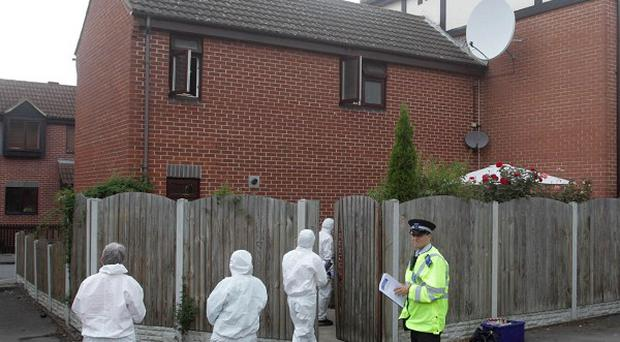 Police officers at the scene of a stabbing in Beckton, east London