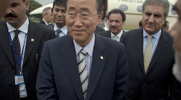 UN Secretary-General Ban Ki-moon, centre, shakes hands with officials at his arrival at Chaklala airbase in Rawalpindi, Pakistan. (AP)