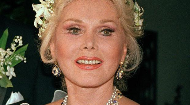 Zsa Zsa Gabor is being returned to hospital because of complications in her recuperation from a broken hip
