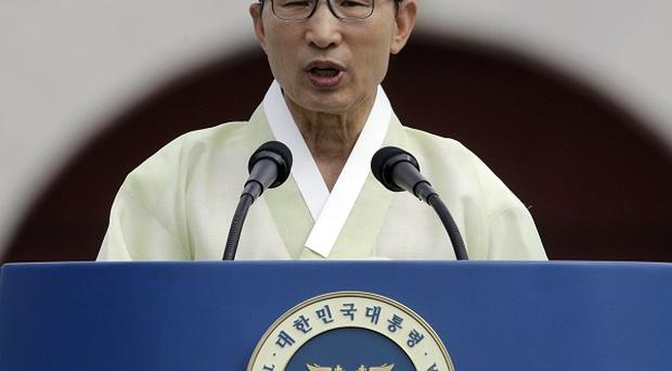 South Korean President Lee Myung-bak delivers a speech to celebrate liberation from Japanese colonial rule