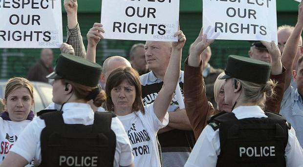 Protesters staged a silent demonstration at an earlier march on the Ardoyne Road