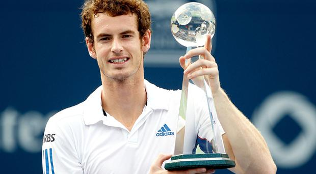 Andy Murray poses for photographers after defeating Roger Federer during the final of the Rogers Cup at the Rexall Centre on August 15, 2010 in Toronto, Canada