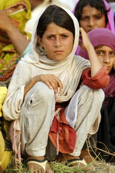 A young girl, who is a Pakistani flood survivor, is shown in the Sultan Colony, a refuge encampment